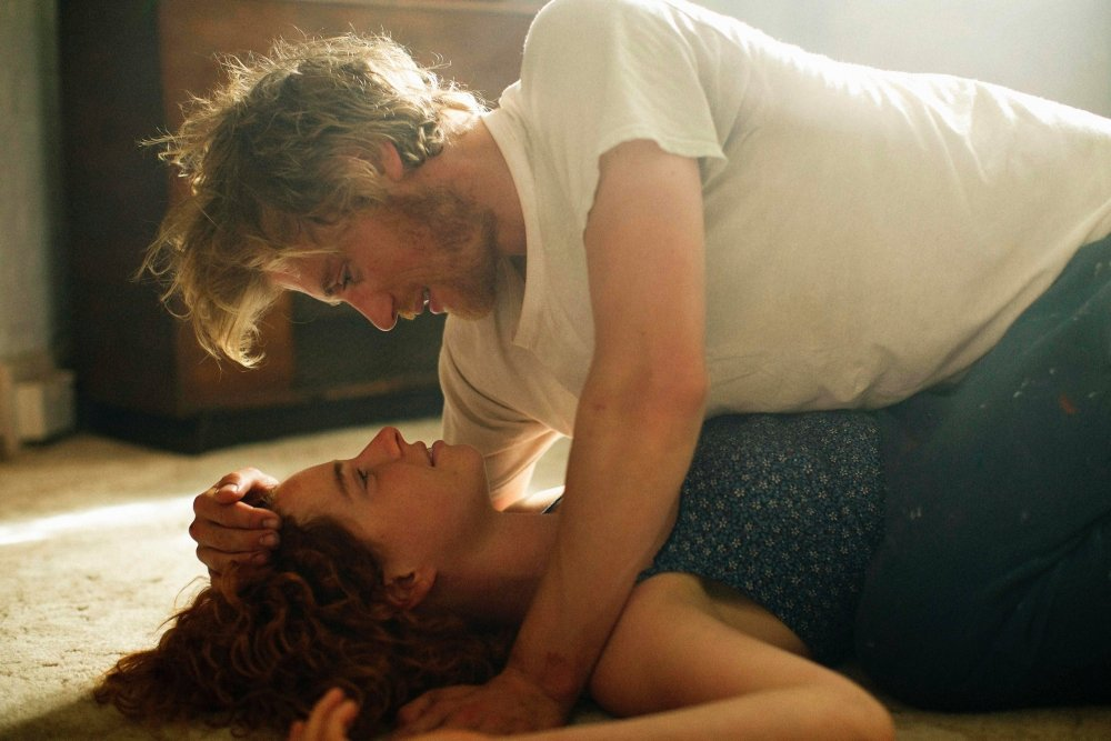 beast-2017-005-jessie-buckley-on-floor-under-michael-flynn